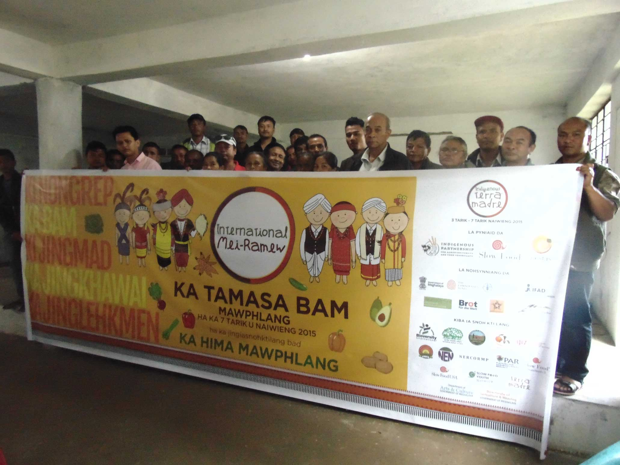 Community presenting the Hima Mawphlang ITM 2015 banner.