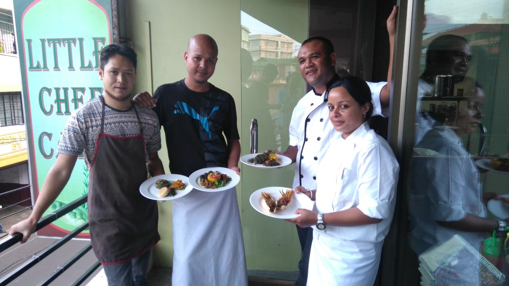 Chefs Artet Kharsati, Daniel Syngkon, Osbert Rynjah and Leony Rynjah holding their creations.