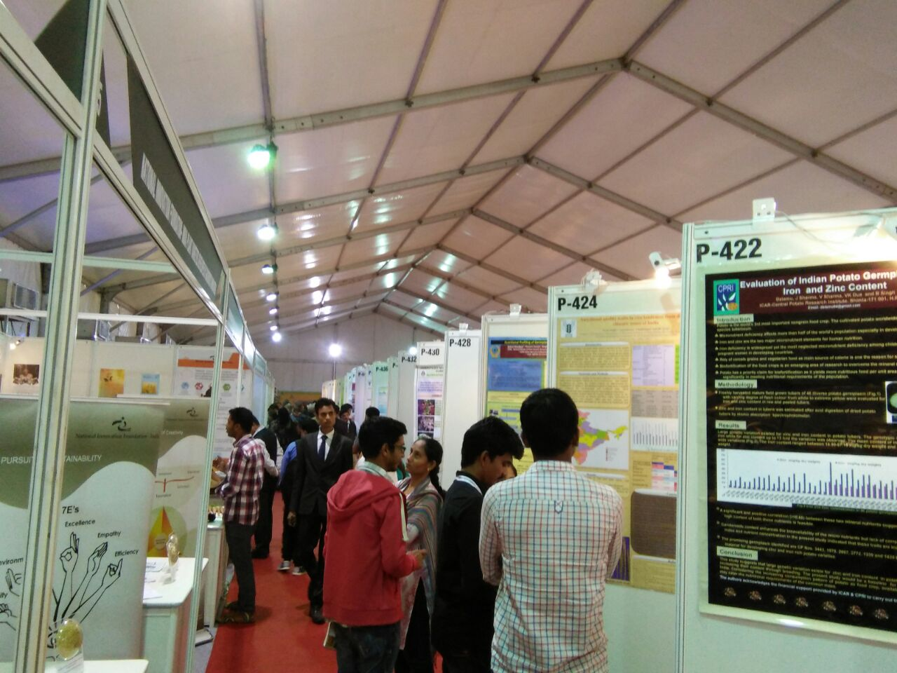 A hallway of poster from various organisations who share their research experiences for sustainable management and utilisation of Agrobiodiversity.