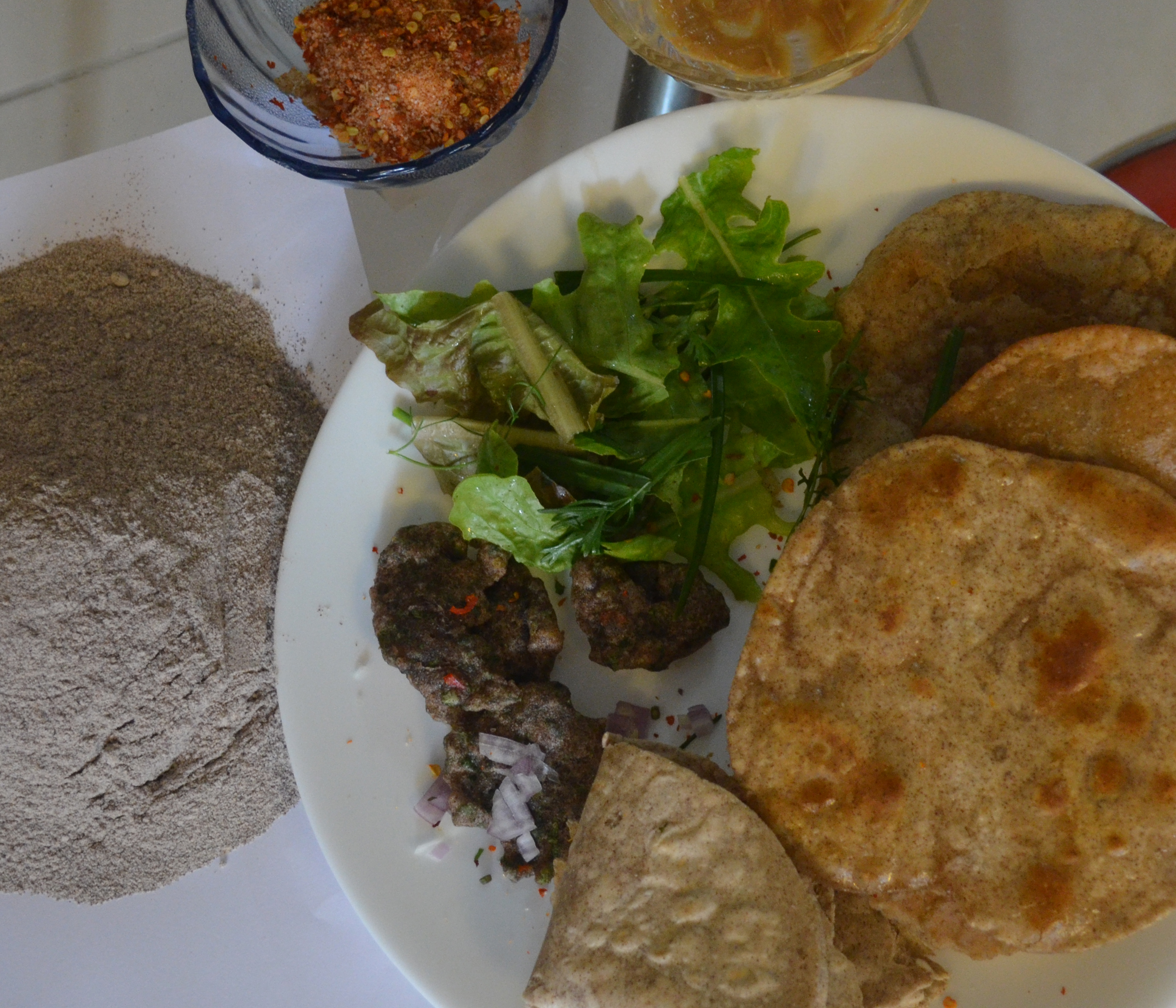 To make pooris, fry the chapatis in cooking oil for a while and its ready to be serve.